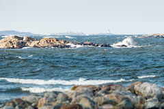 Lighthouse at the coast during windy conditions Royalty Free Stock Images