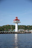 Lighthouse on coastal area. Stock Image
