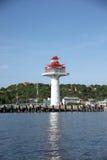 Lighthouse on coastal area. Stock Image