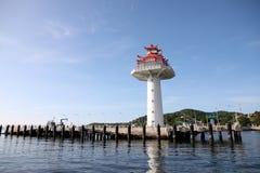 Lighthouse on coastal area. Royalty Free Stock Photo
