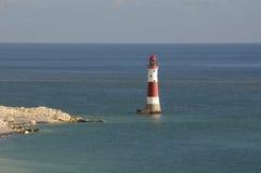 Lighthouse and coastline Stock Photos