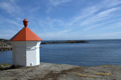Lighthouse on coastline Stock Photography