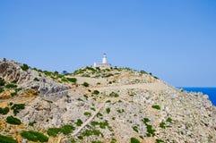 Lighthouse on coastline Stock Photo