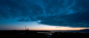 The lighthouse color. Light emitting from a lighthouse (panorama). Also available in B&W royalty free stock photos