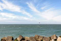 Lighthouse and concrete wave breakers at the North Sea near Rott Stock Photos