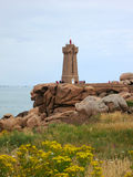 Lighthouse at Cote de Granite Rose, Brittany Stock Images