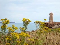 Lighthouse at Cote de Granite Rose, Brittany Stock Photography