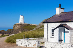 Lighthouse and cottage Stock Images