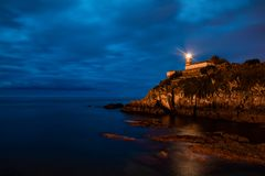 Lighthouse Cudillero in the region of Asturias in the north of Spain. stock photography