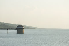Lighthouse at dam Stock Photo