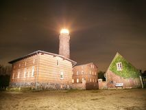 Lighthouse at Darsser Ort is shining in dark night. National park at Prerow,. Baltic Sea,  Mecklenburg-West Pomerania, Germany Stock Photos