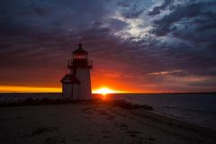 Lighthouse at dawn in Nantucket. June 25, 2017 Nantucket Massachusetts - A Light house stands at dawn under an amazing skyscape as the sun rises Stock Photography