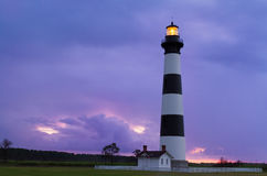 Lighthouse at Dawn. North Carolina's Bodie Island Lighthouse shining with a colorful dawn sky behind in Cape Hatteras National Seashore Royalty Free Stock Photography