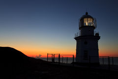 Lighthouse at dawn Stock Photography