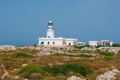 Cavalleria lighthouse off in Menorca island stock photos