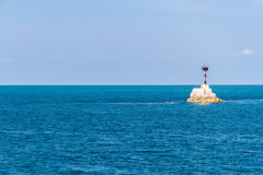 Lighthouse With Deep Blue Sea And Cloud Sky Background Stock Images