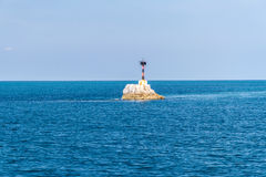Lighthouse With Deep Blue Sea And Cloud Sky Background Stock Photos