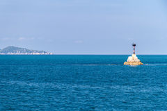 Lighthouse With Deep Blue Sea And Cloud Sky Background Stock Photography