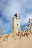 Lighthouse in desert by the sea Royalty Free Stock Photo