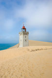 Lighthouse in desert by the sea Stock Image