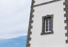 Lighthouse detail with window. Overlooking the sea Stock Images