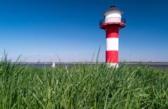 Lighthouse on the Dike in Germany. Elbe river View Royalty Free Stock Photography
