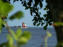 Lighthouse in the Distance. A lighthouse through the trees stock photography