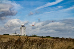 The lighthouse of Dover cliffs. A landscape photo of an old lighthouse on top of the Dover cliffs Royalty Free Stock Photos