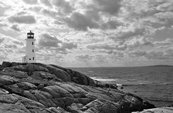 Lighthouse with dramatic sky, b&w Stock Images