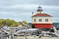 Lighthouse and driftwood Royalty Free Stock Photos