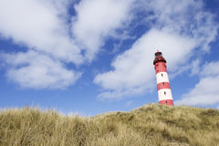 Lighthouse in dunes Stock Photos