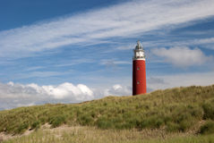 Lighthouse and dunes Stock Image