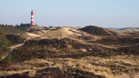 Lighthouse over the dunes at Amrum stock photos