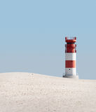 Lighthouse in dunes Stock Image