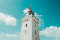 Lighthouse on dunes and clear sky. Lighthouse on dunes and clear blue sky Stock Images