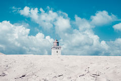 Lighthouse on dunes and clouds. Lighthouse, on dunes and clouds Royalty Free Stock Photos