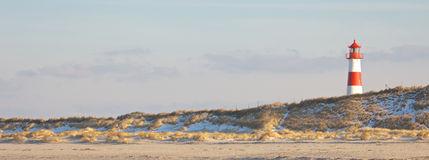 Lighthouse and dunes wide Royalty Free Stock Photography