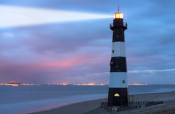 Lighthouse in the dusk. Vuurtoren Breskens lighthouse in the Netherlands stock photography
