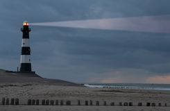 Lighthouse in the dusk. Vuurtoren Breskens lighthouse in the Netherlands shining in the night Stock Photos