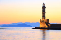 Lighthouse in dusk colors Chania Crete. Seascape view of lighthouse in dusk colors Chania Crete Stock Images