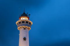 Lighthouse at the Dutch coast in Egmond aan Zee. During night time stock images