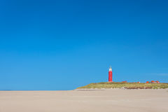 Lighthouse at the Dutch island of Texel. Lighthouse with houses at the Dutch Wadden island of Texel stock photos