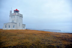 Lighthouse at Dyrholaey Cape. In South Iceland stock photo