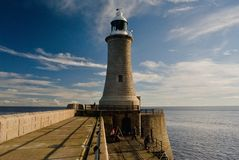 Lighthouse of the east british coast and Tynemouth pier, morning sunlight Royalty Free Stock Photos