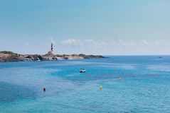 Lighthouse and seacoast of the Favaritx area in Menorca island stock photo