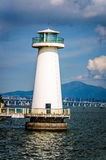 Lighthouse. The edge of the sea a towering lighthouse Stock Photography