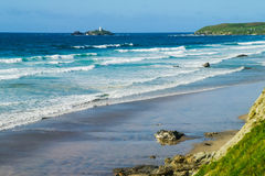 Lighthouse and empty beach at Godrevy Point. Cornwall Royalty Free Stock Photo