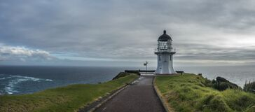 Lighthouse with footpath and green grass all around