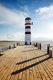 Lighthouse in the end of pier Stock Photos