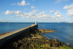 Lighthouse at end of pier Royalty Free Stock Image